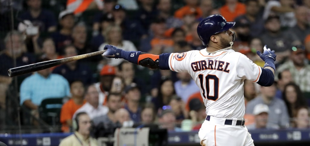 Houston Astros' Yuli Gurriel watches his two-run home run against the Colorado Rockies during the second inning of a baseball game Wednesday, Aug. 15,...