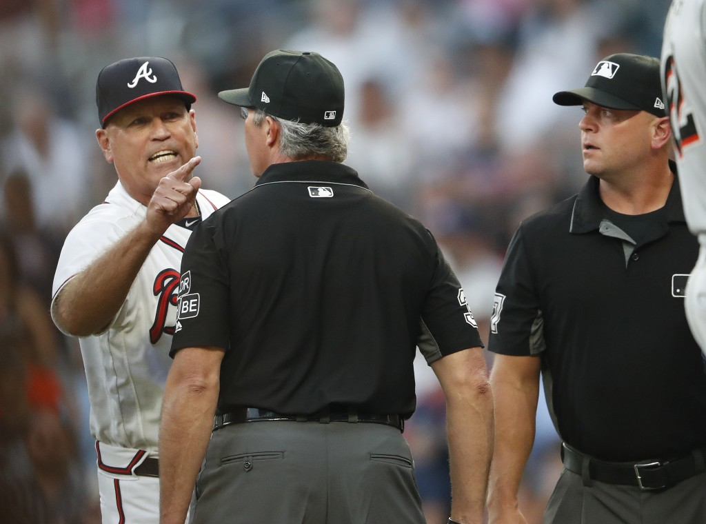 Atlanta Braves manager Brian Snitker argues with the umpiring crew after Ronald Acuna Jr was hit by a pitch from Miami Marlins starting pitcher Jose U...