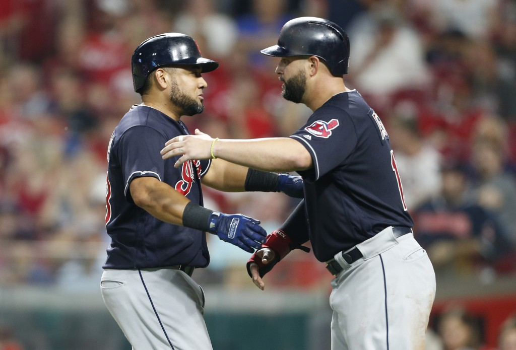 Cleveland Indians' Melky Cabrera, left, gets a hug from Yonder Alonso following Cabrera's a two-run home run off Cincinnati Reds relief pitcher Cody R...