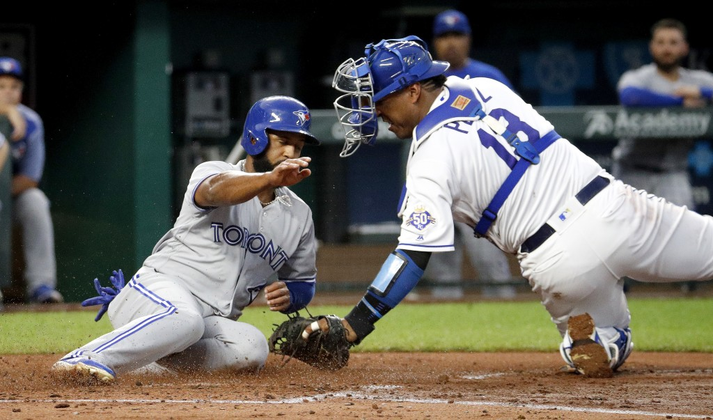 Toronto Blue Jays' Richard Urena is tagged out by Kansas City Royals catcher Salvador Perez as he tried to score on a single by Randal Grichuk during ...