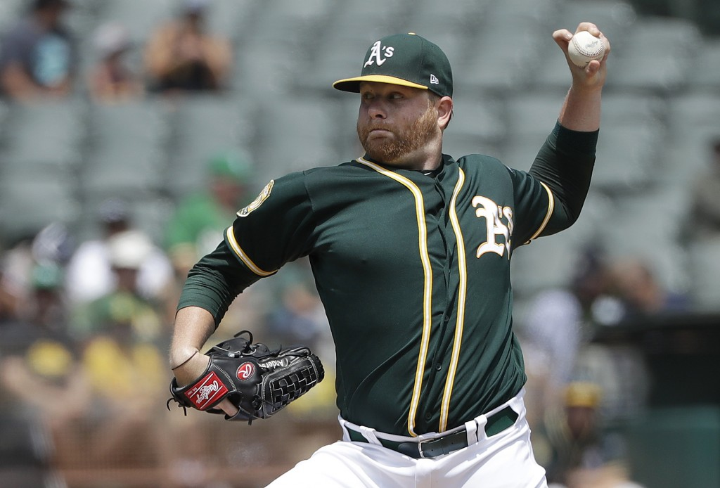 Oakland Athletics pitcher Brett Anderson throws against the Seattle Mariners during the second inning of a baseball game in Oakland, Calif., Wednesday...