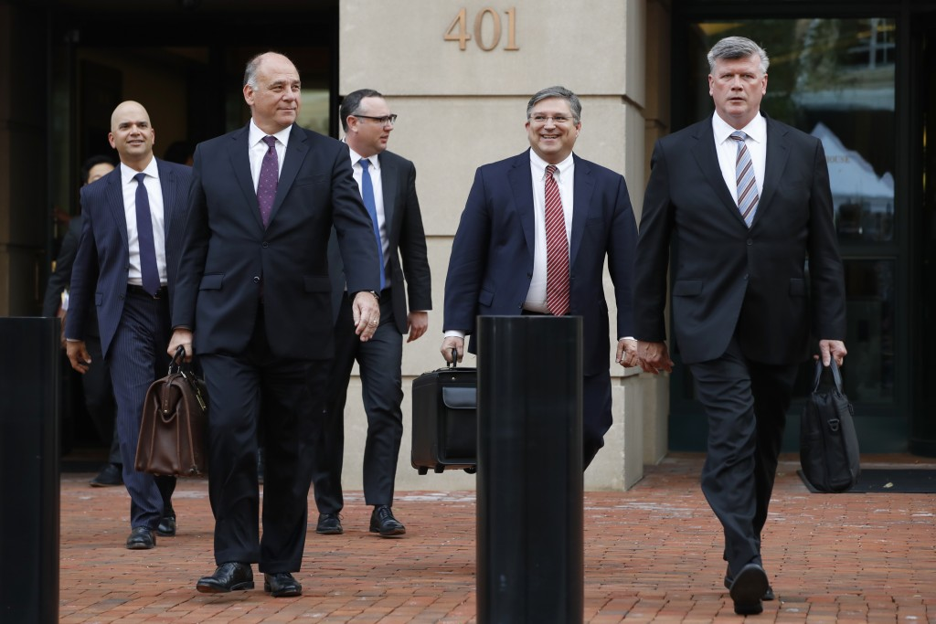 Members of the defense team for Paul Manafort, from left, Jay Nanavati, Thomas Zehnle, Brian Ketcham, Richard Westling, and Kevin Downing, leave feder...