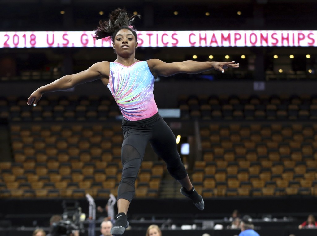 Simone Biles practices on the floor during a training session at the U.S. Gymnastics Championships, Wednesday, Aug. 15, 2018, in Boston. (AP Photo/Eli...