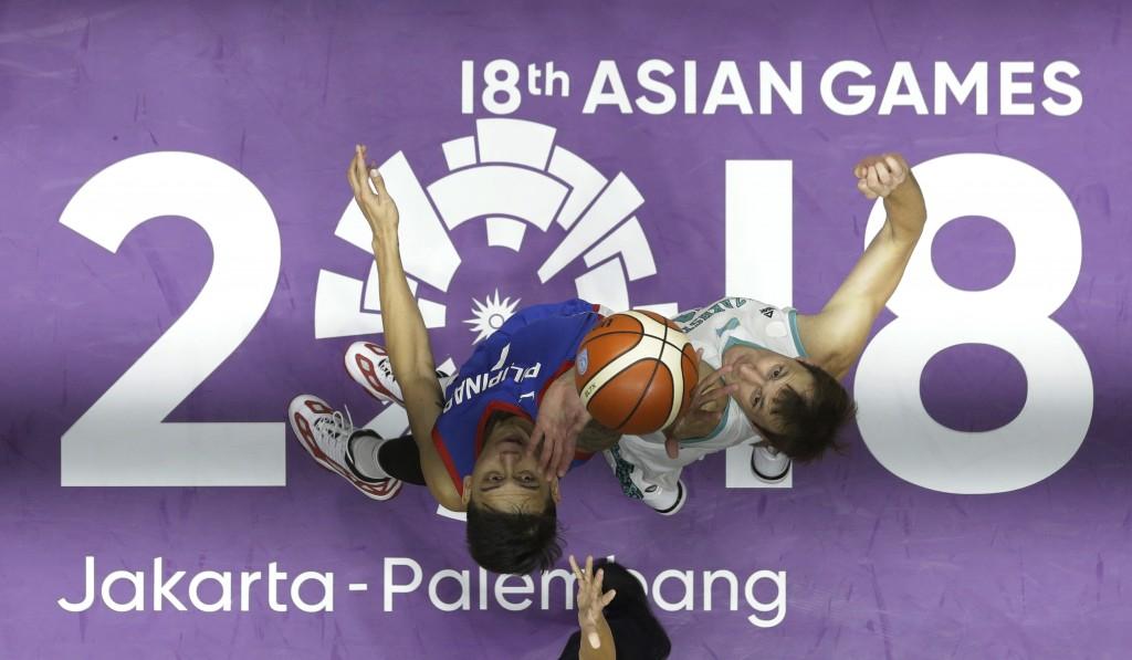 In this Aug. 16, 2018, file photo, Philippines' John Erram, left, and Kazakhstan's Dmitriy Gavrilov jump for ball possession during their men's basket...