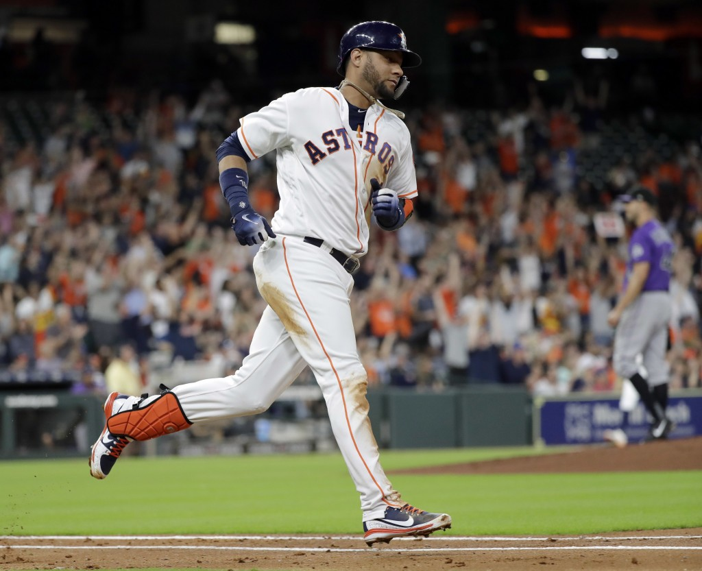 Houston Astros' Yuli Gurriel runs the bases after hitting a two-run home run against the Colorado Rockies during the second inning of a baseball game ...