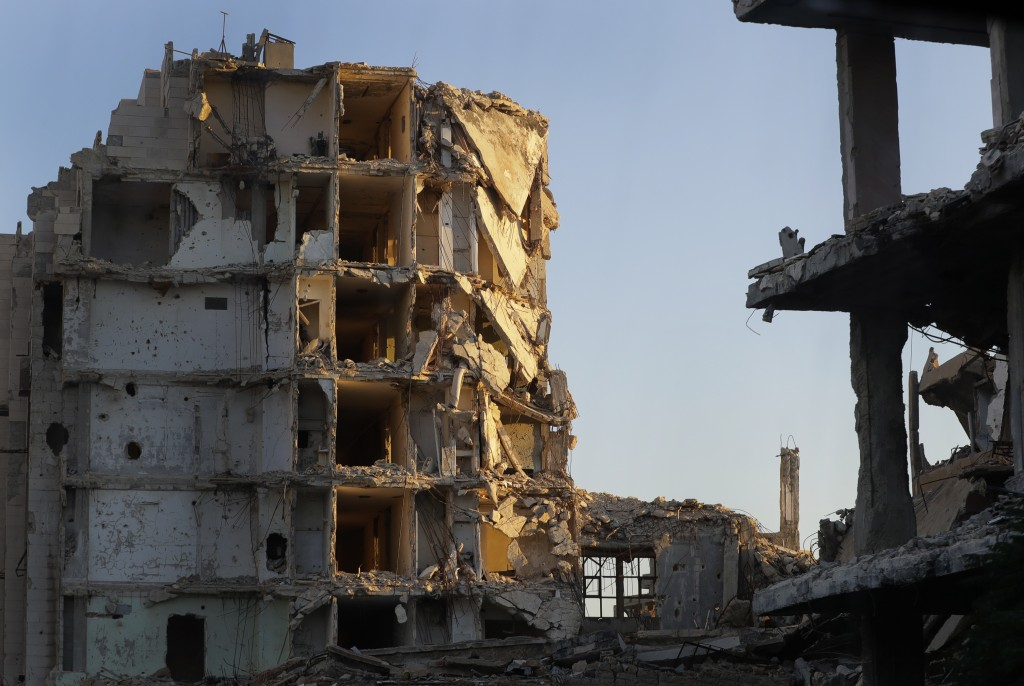 Buildings are in ruins in the old city of Homs, Syria, Wednesday, Aug. 15, 2018. The Russian Defense Ministry said it is coordinating efforts to help ...