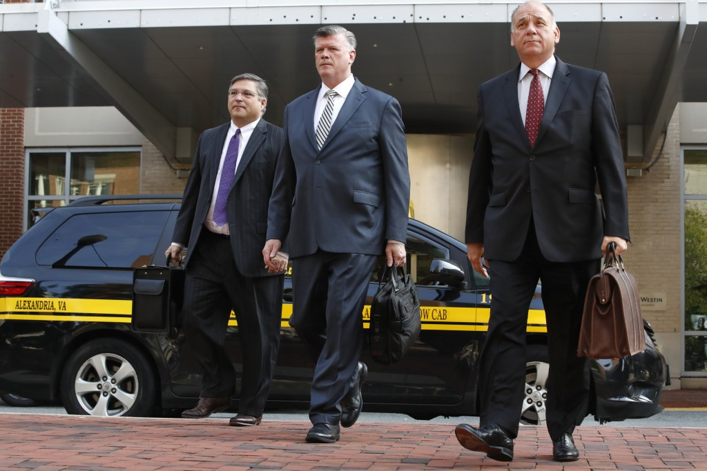 Defense attorneys Richard Westling, left, Kevin Downing, and Thomas Zehnle, walk to federal court as jury deliberations begin in the trial of former T...