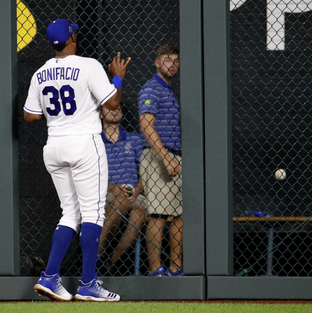 Kansas City Royals' Jorge Bonifacio watches a grand slam by Toronto Blue Jays' Curtis Granderson during the fourth inning of a baseball game Wednesday...
