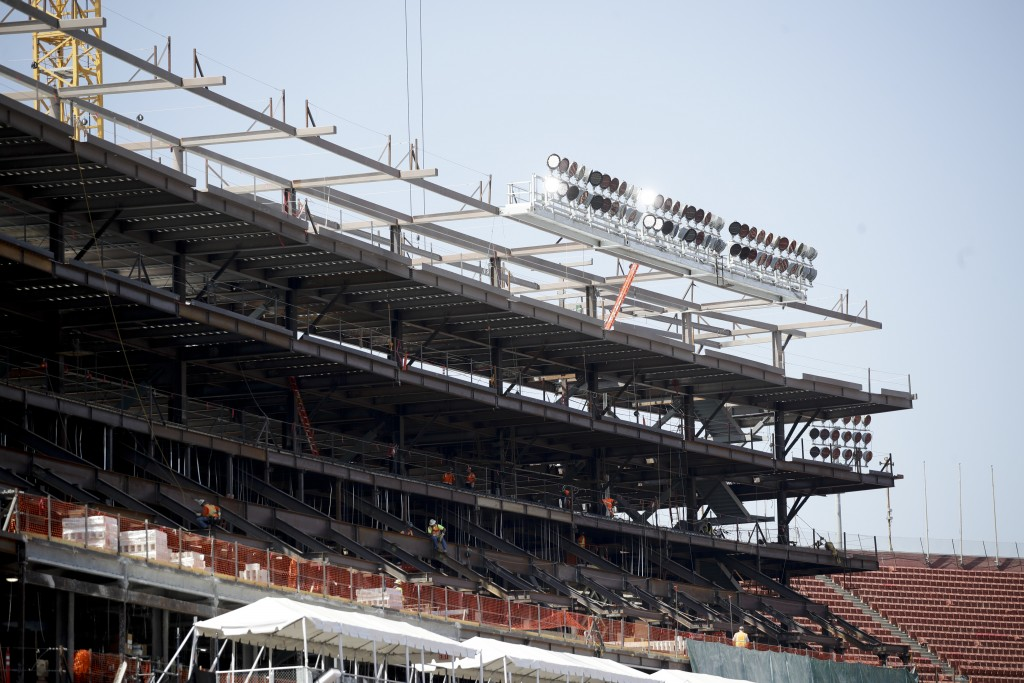 Stadium personnel work on a new section of the Los Angeles Memorial Coliseum in Los Angeles, Wednesday, Aug. 15, 2018. The 95-year-old Coliseum is onl...