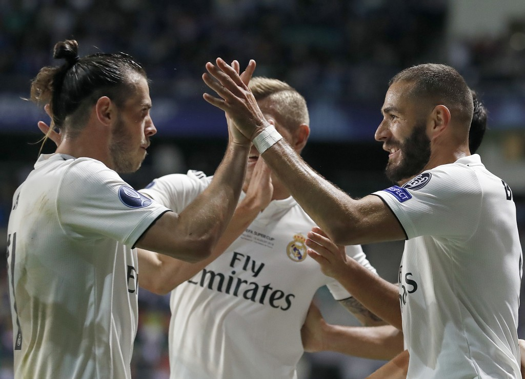 Real Madrid's Gareth Bale, left, and Real Madrid's Karim Benzema celebrate after scoring their side's first goal during the UEFA Super Cup final socce...