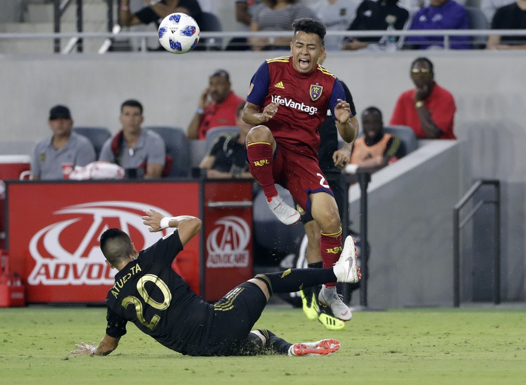 Real Salt Lake forward Sebastian Saucedo, top, is fouled by Los Angeles FC midfielder Eduard Atuesta (20) during the first half of an MLS soccer match...