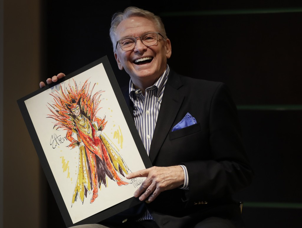 Fashion and Costume Designer Bob Mackie poses with one of his illustrations, a marker and pencil costume sketch of Elton John as a devil for his 1986 ...