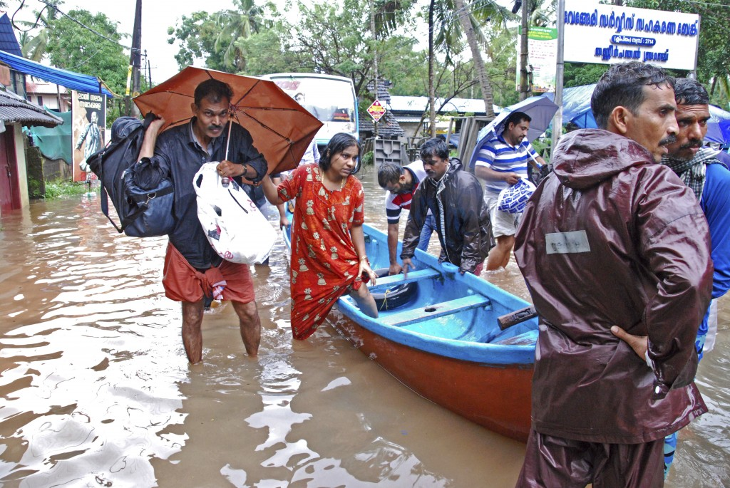 Flood victims are evacuated to safer areas in Kozhikode, in the southern Indian state of Kerala, Thursday, Aug. 16, 2018. Torrential monsoon rains hav...