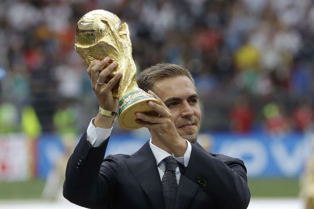 FILE - In this July 15, 2018 file photo former German soccer team captain Philipp Lahm displays the trophy before the final match between France and C...