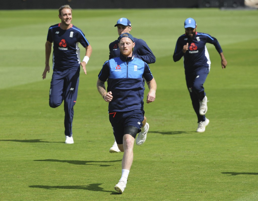 England's Ben Stokes, front, warms up during a nets session ahead of the third Test Match between England and India at Trent Bridge in Nottingham, Eng...