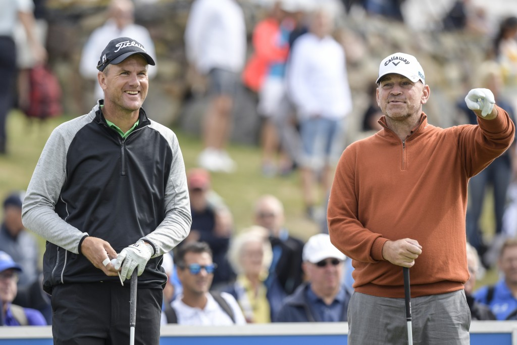 Sweden's Robert Karlsson, left, and Thomas Bjorn of Denmark at the first tee during the first round of Nordea Masters at Hills Golf Club, Gothenburg, ...