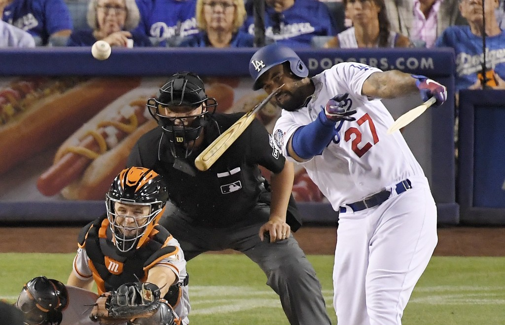 Los Angeles Dodgers' Matt Kemp, right, breaks his bat as he hits a single while San Francisco Giants catcher Buster Posey and home plate umpire Stu Sc...