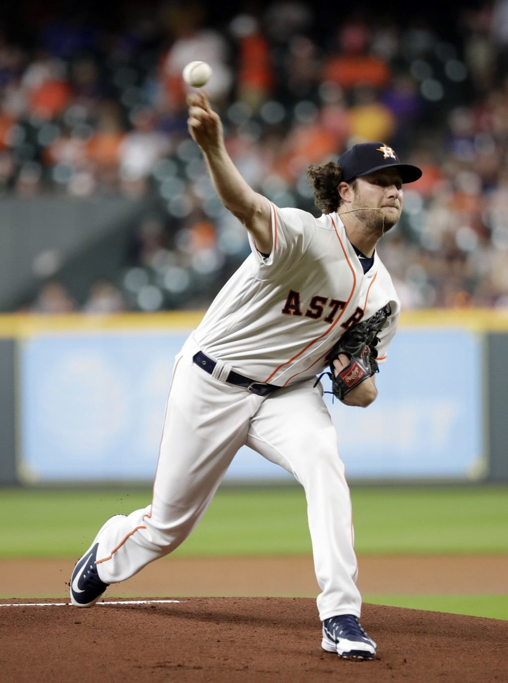 Houston Astros starting pitcher Gerrit Cole throws to a Colorado Rockies batter during the first inning of a baseball game Wednesday, Aug. 15, 2018, i...