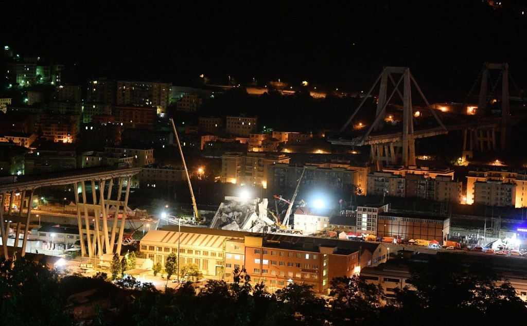 A night view of the collapsed Morandi bridge in Genoa, Italy, Wednesday, Aug. 15, 2018. A highway bridge collapsed Monday killing at least 39 people. ...