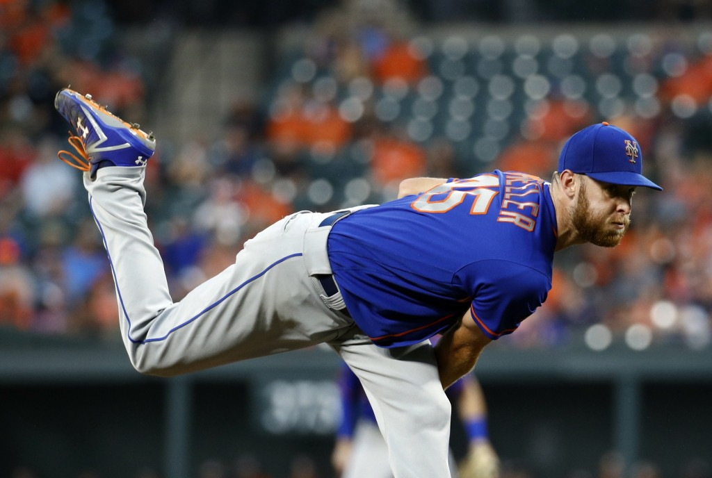 New York Mets starter Zack Wheeler follows through on a pitch to the Baltimore Orioles during the second inning of a baseball game Wednesday, Aug. 15,...
