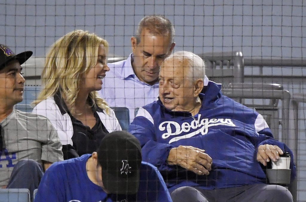 Los Angeles Lakers president Jeanie Buss, left, talks with former Los Angeles Dodgers manager Tommy Lasorda during the fourth inning of a baseball gam...