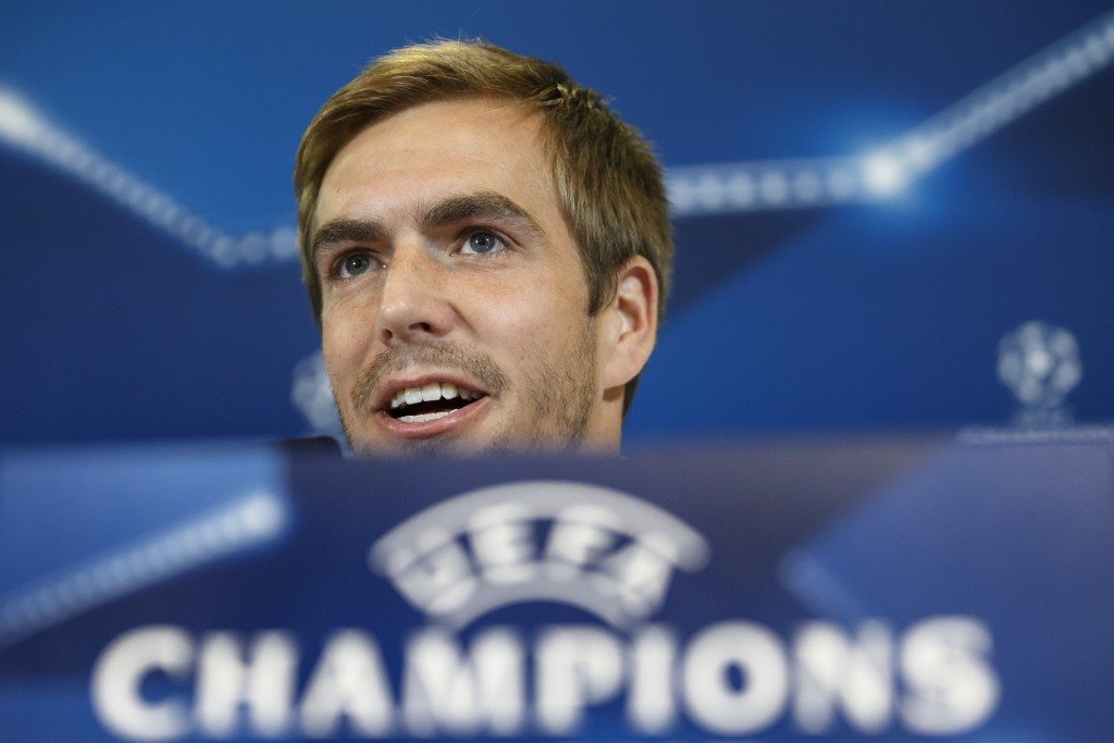 FILE - In this Sept. 27, 2016 file photo FC Bayern Munich player Philipp Lahm speaks during a press conference before a training session ahead of Wedn...