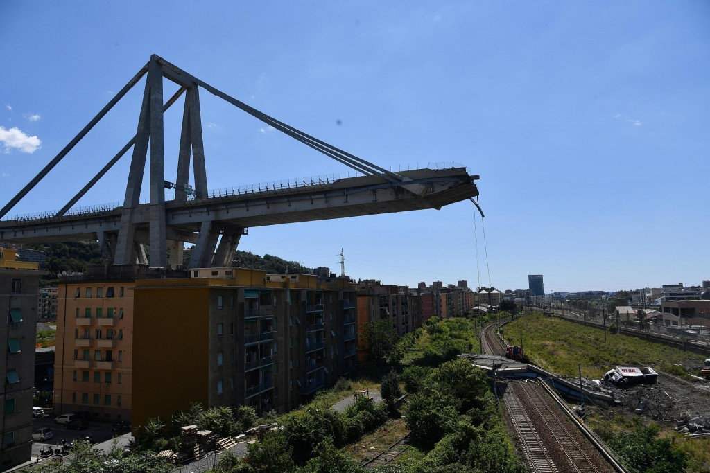 A view of the evacuated houses built under the remains part of the collapsed Morandi highway bridge, in Genoa, northern Italy, Wednesday, Aug. 15, 201