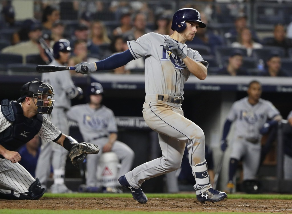Tampa Bay Rays' Brandon Lowe watches his RBI single during the fifth inning of a baseball game against the New York Yankees on Wednesday, Aug. 15, 201...