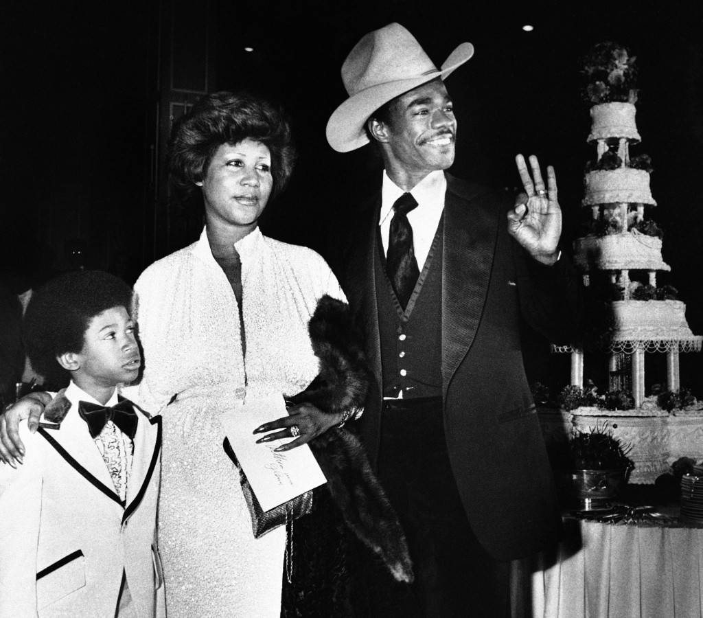 FILE - In this April 17, 1978 file photo, Aretha Franklin and her new husband, Glen Turman, arrive at a Los Angeles hotel for their wedding reception....
