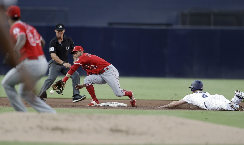 Los Angeles Angels shortstop David Fletcher, center, reaches for the throw as San Diego Padres' Wil Myers, right, steals second base during the first ...