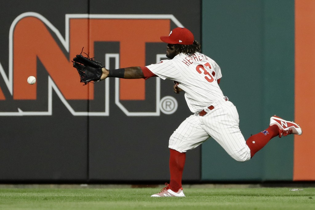 Philadelphia Phillies center fielder Odubel Herrera cannot reach a three-run double by Boston Red Sox's Mitch Moreland during the third inning of a ba...