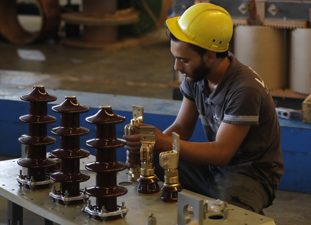 A worker assembles a transformer at the plant in the city of Adra, Syria, Wednesday, Aug. 15, 2018. The Russian Defense Ministry said Wednesday it is ...