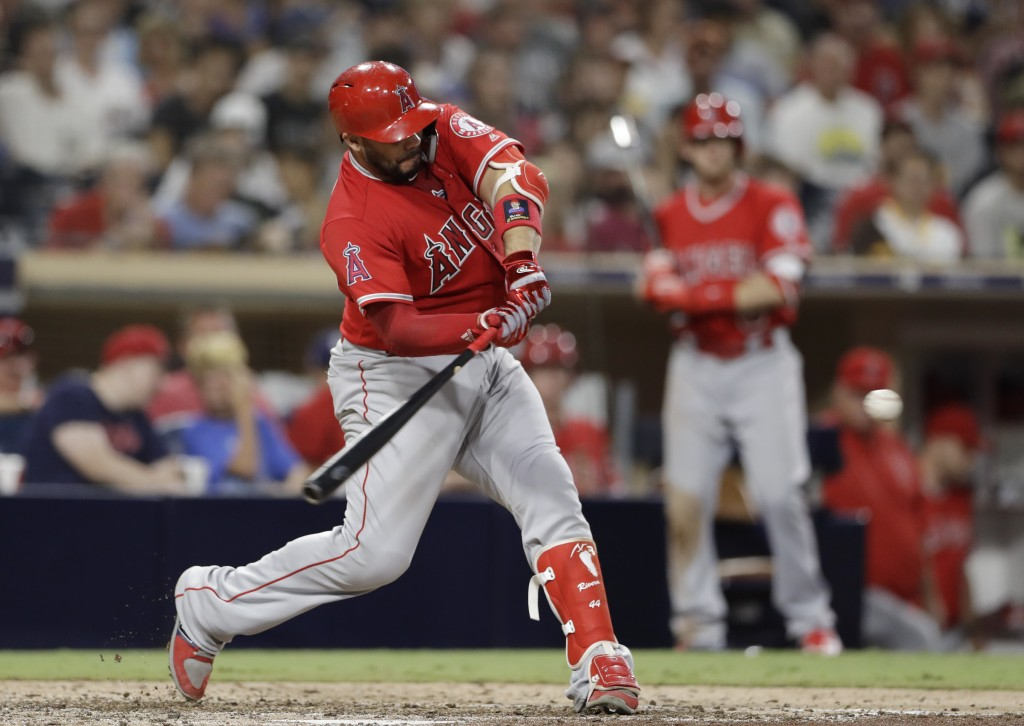 Los Angeles Angels' Rene Rivera hits a home run during the ninth inning against the San Diego Padres in a baseball game Wednesday, Aug. 15, 2018, in S...