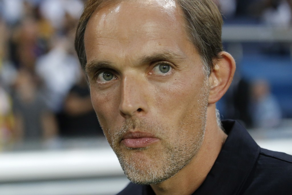 FILE - In this Sunday, Aug. 12, 2018 file photo, PSG's coach Thomas Tuchel arrives on the pitch on the start of their League One soccer match against ...