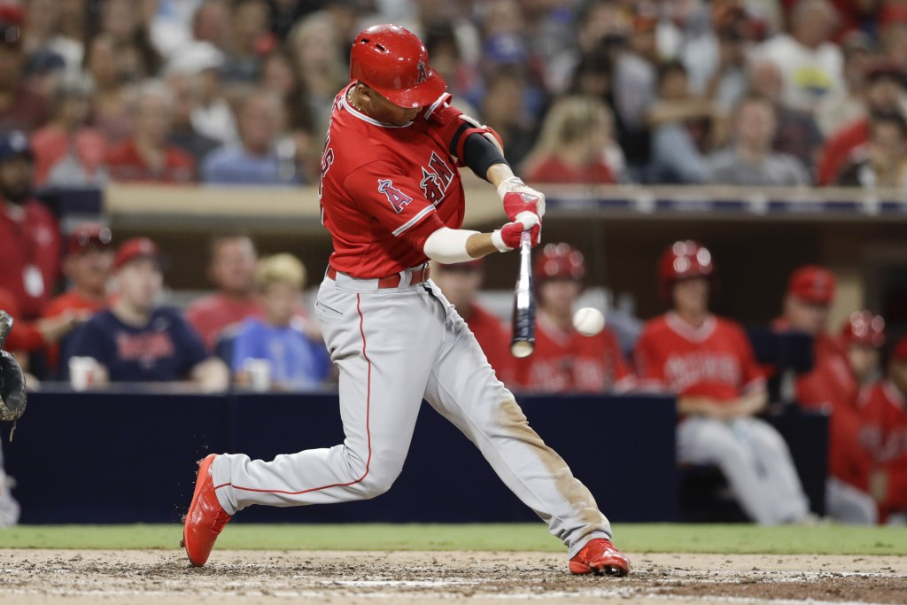 Los Angeles Angels' Andrelton Simmons hits an RBI-single during the sixth inning of a baseball game against the San Diego Padres on Wednesday, Aug. 15...