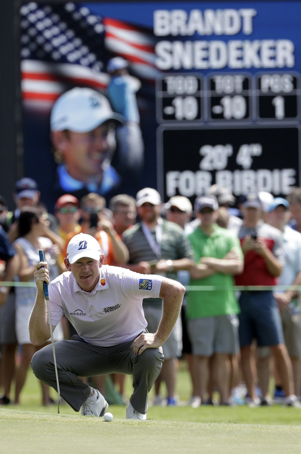 Brandt Snedeker lines up a birdie putt on the ninth hole during the first round of the Wyndham Championship golf tournament in Greensboro, N.C., Thurs...