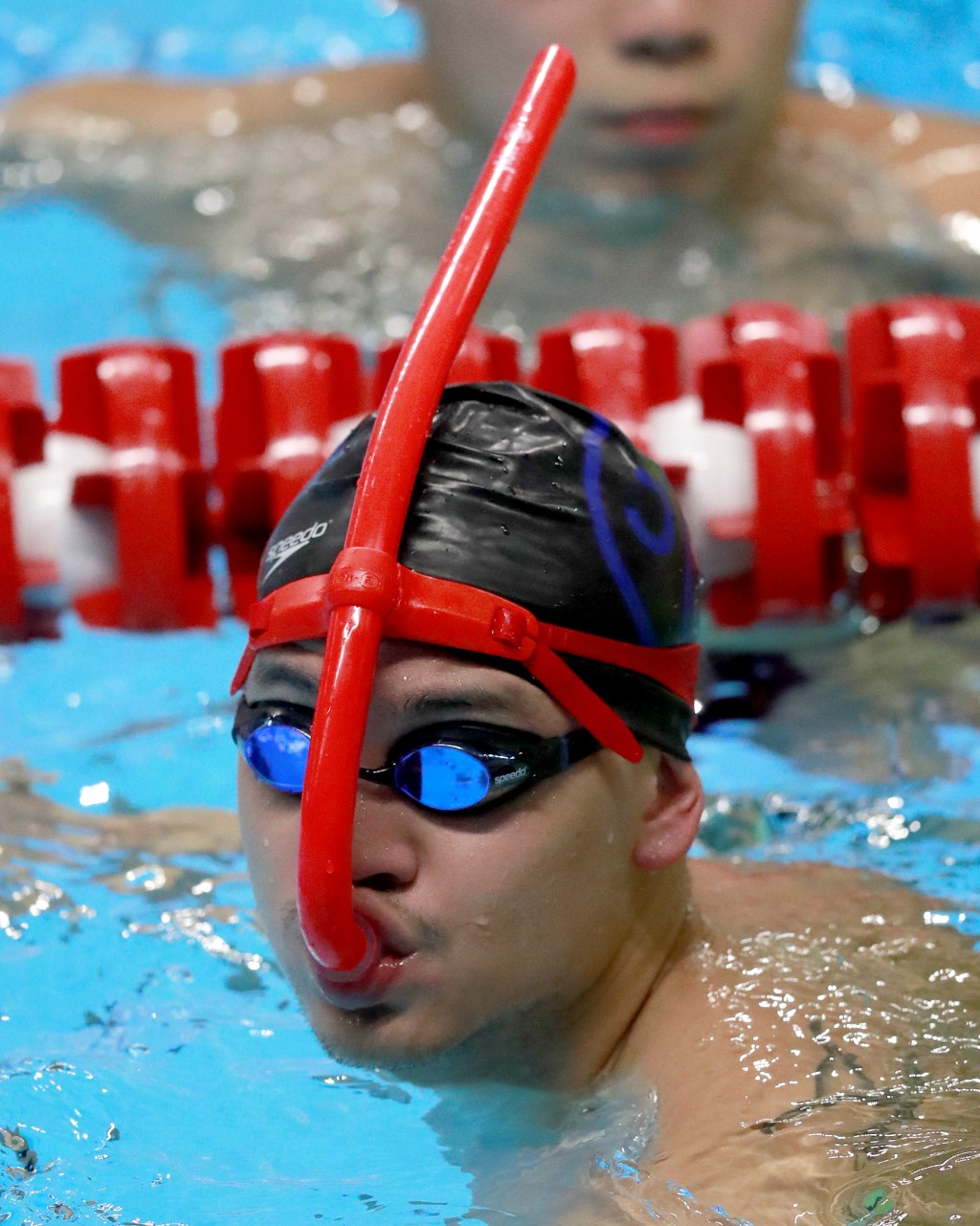 Singapore's Joseph Schooling swims during a training session at the 18th Asian Games in Jakarta, Indonesia, Friday, Aug. 17, 2018. (AP Photo/Bernat Ar...