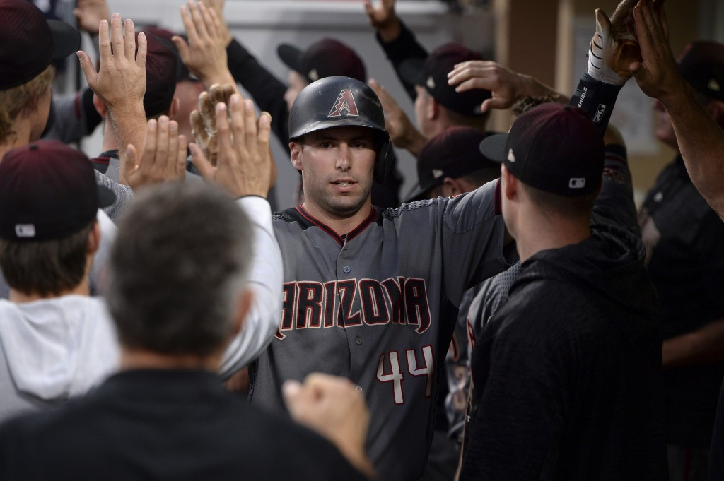 Arizona Diamondbacks' Paul Goldschmidt is congratulated in the dugout after scoring on a single by Alex Avila during the first inning of a baseball ga...