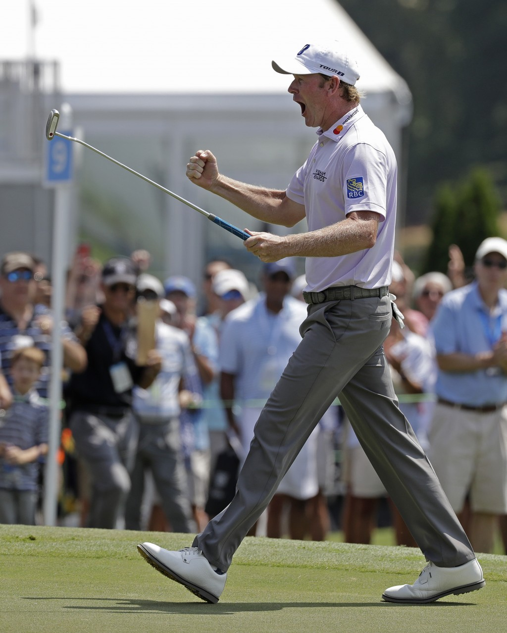 Brandt Snedeker reacts after making a birdie putt on the ninth hole during the first round of the Wyndham Championship golf tournament in Greensboro, ...