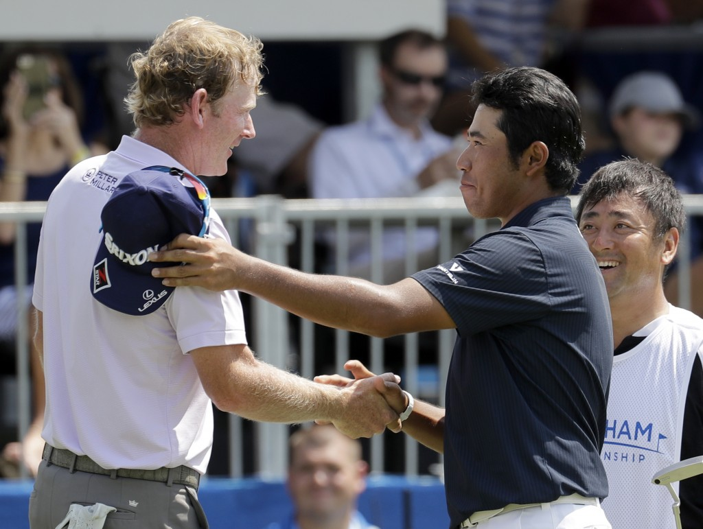 Brandt Snedeker, left, is congratulated by playing partner Hideki Matsuyama, right, after finishing their round on the ninth hole during the first rou...