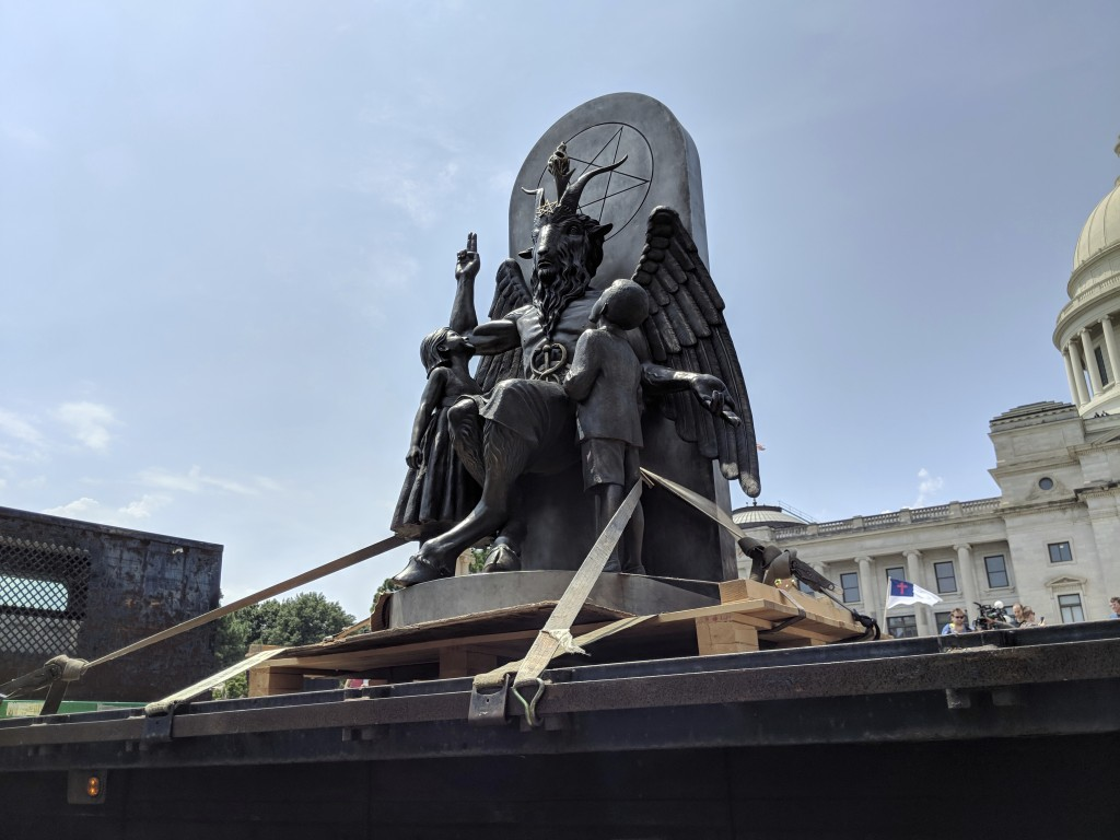 The Satanic Temple unveils its statue of Baphomet, a winged-goat creature, at a rally for the first amendment in Little Rock, Ark., Thursday, Aug. 16,...