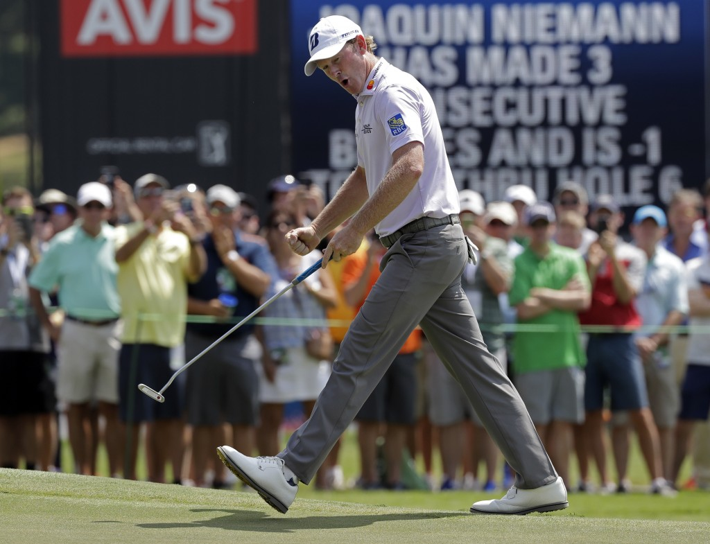 Brandt Snedeker reacts to making a birdie putt on the ninth hole during the first round of the Wyndham Championship golf tournament in Greensboro, N.C...