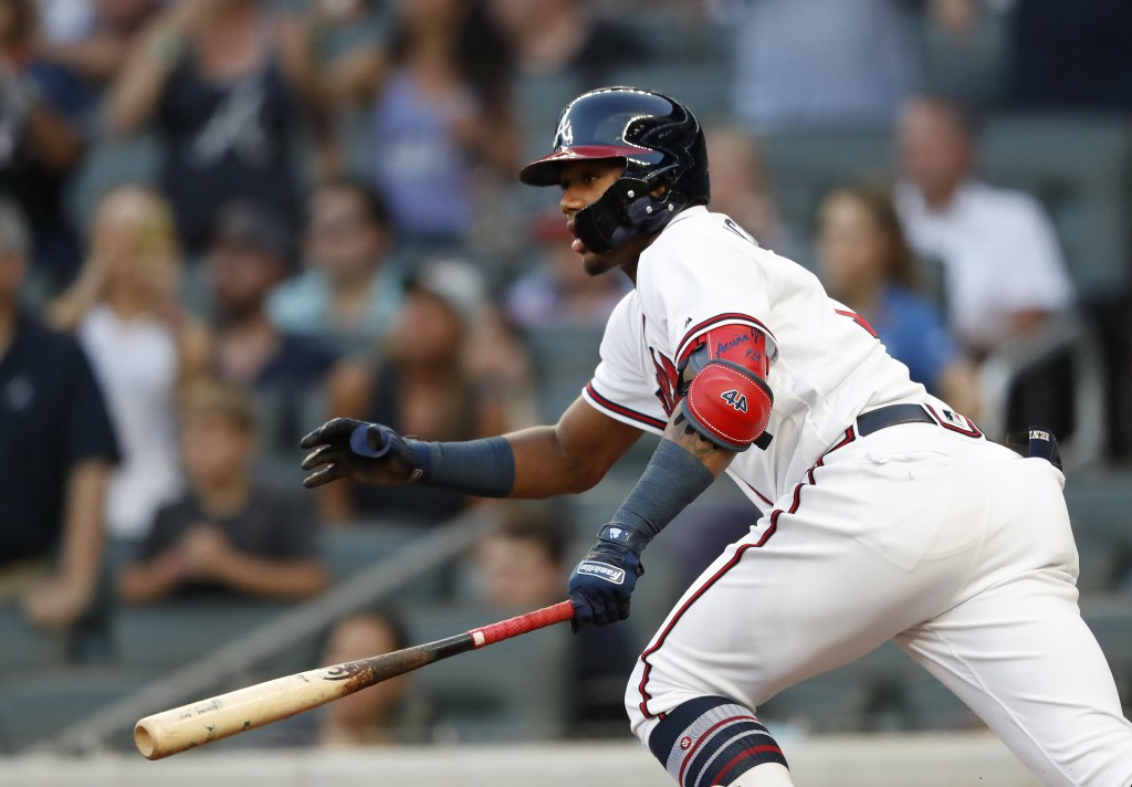 Atlanta Braves' Ronald Acuna Jr. runs to first base after hitting a single in the first inning of a baseball game against the Colorado Rockies on Thur...