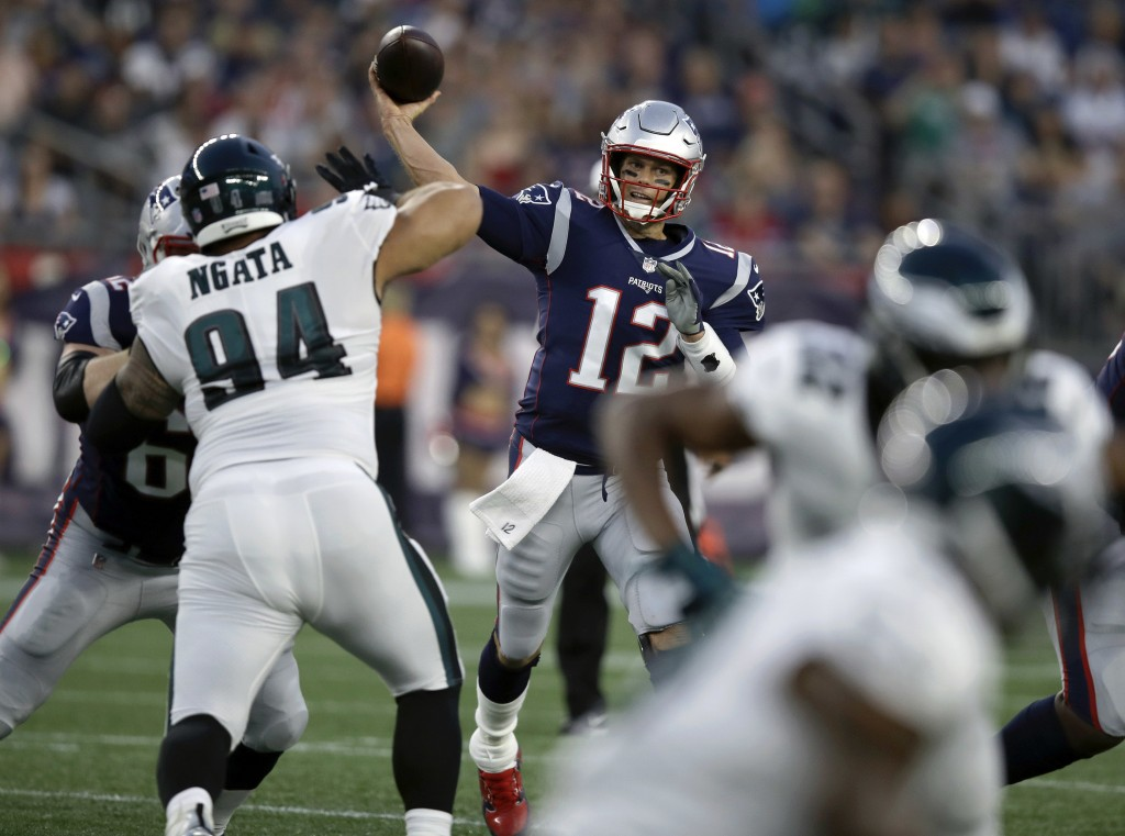 New England Patriots quarterback Tom Brady (12) throws a pass under pressure from Philadelphia Eagles defensive tackle Haloti Ngata (94) during the fi...