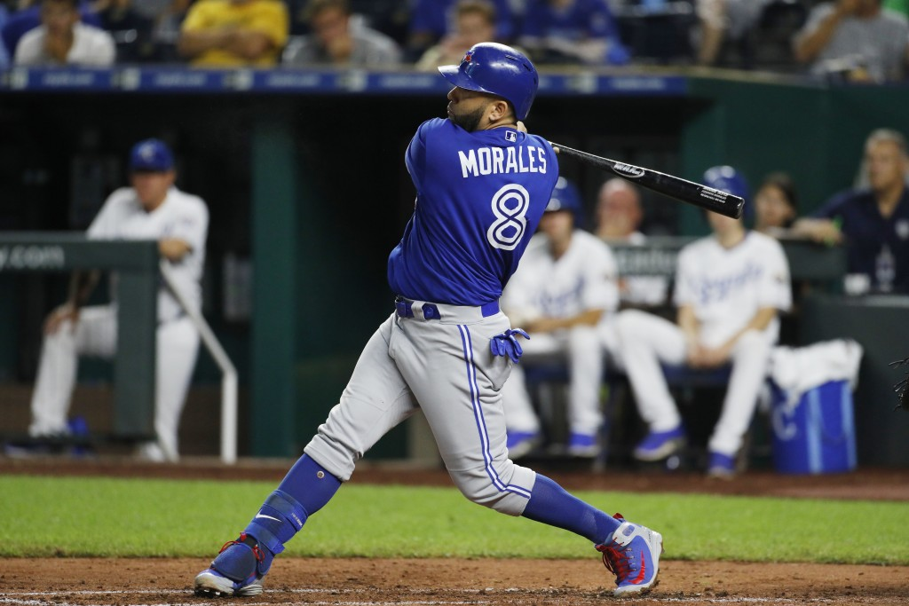 Toronto Blue Jays' Kendrys Morales follows through on an RBI single in the fourth inning of a baseball game against the Kansas City Royals at Kauffman...