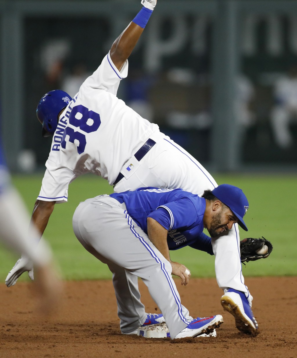 Kansas City Royals' Jorge Bonifacio (38) is tagged out at second base by Toronto Blue Jays second baseman Devon Travis while attempting to stretch a s...