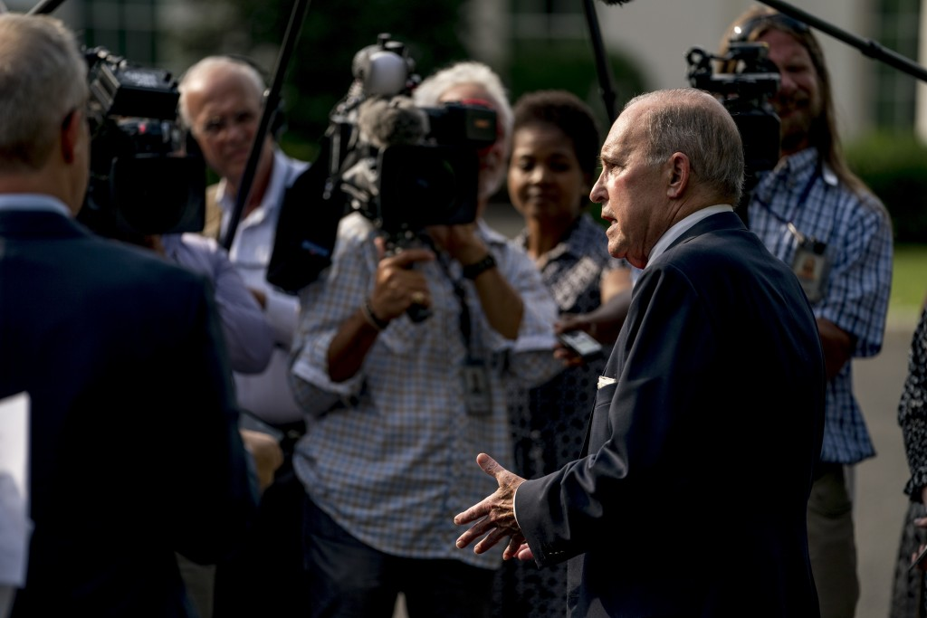 White House chief economic adviser Larry Kudlow speaks to the media after finishing interviews on the North Lawn of the White House, Thursday, Aug. 16...