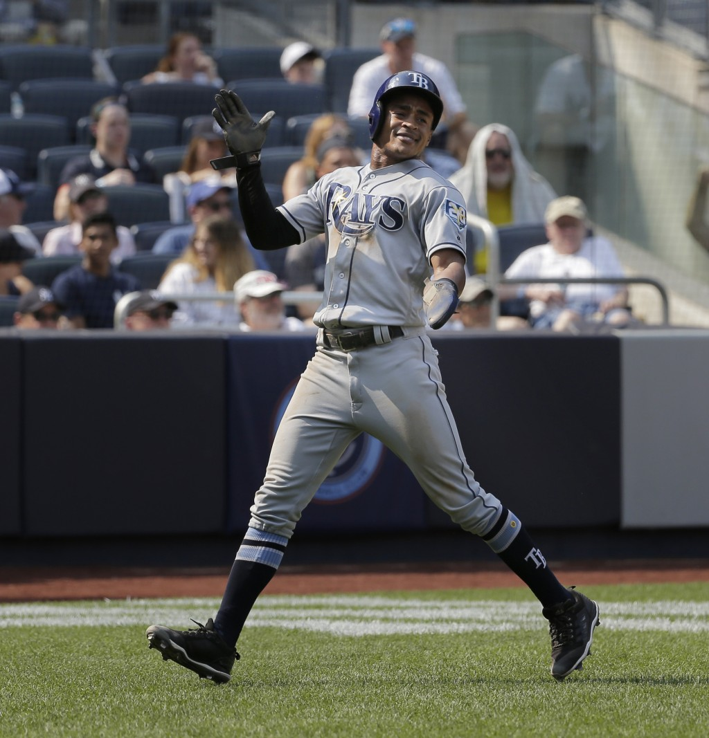 Tampa Bay Rays' Mallex Smith reacts after crossing home plate during the eighth inning of a baseball game against the New York Yankees at Yankee Stadi...