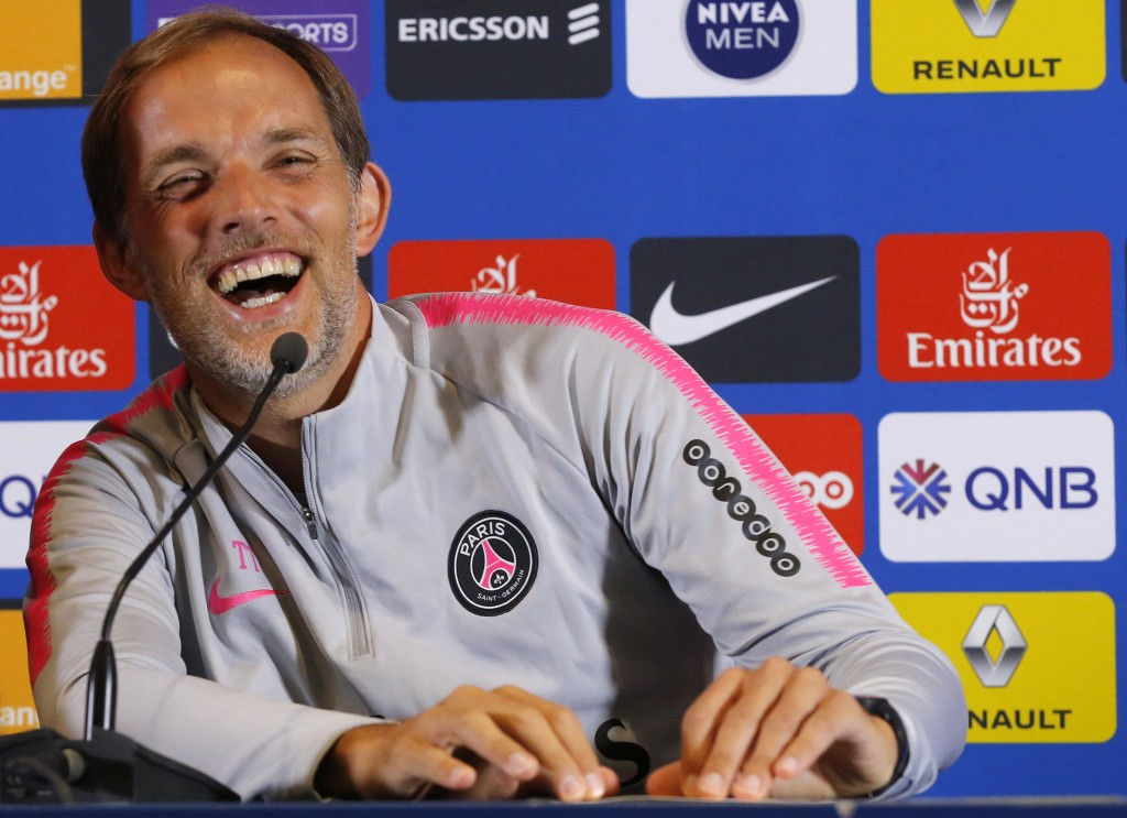 PSG's coach Thomas Tuchel laughs during a press conference at the club training center in Saint Germain en Laye, west of Paris, Friday, Aug.17, 2018. ...