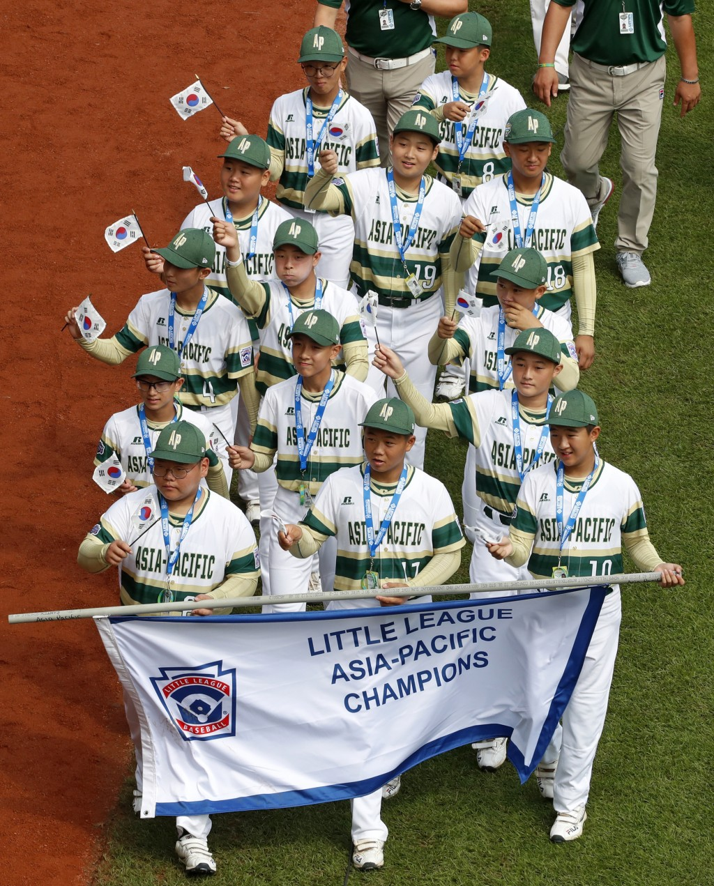 The Asia-Pacific Region Champion Little League team from Seoul, South Korea, participates in the opening ceremony of the 2018 Little League World Seri...